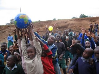 Students play with a globe and sun